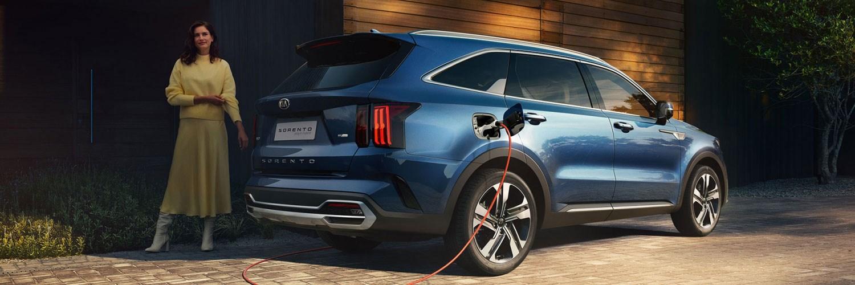 Sorento Plug-In Hybrid with lady charging