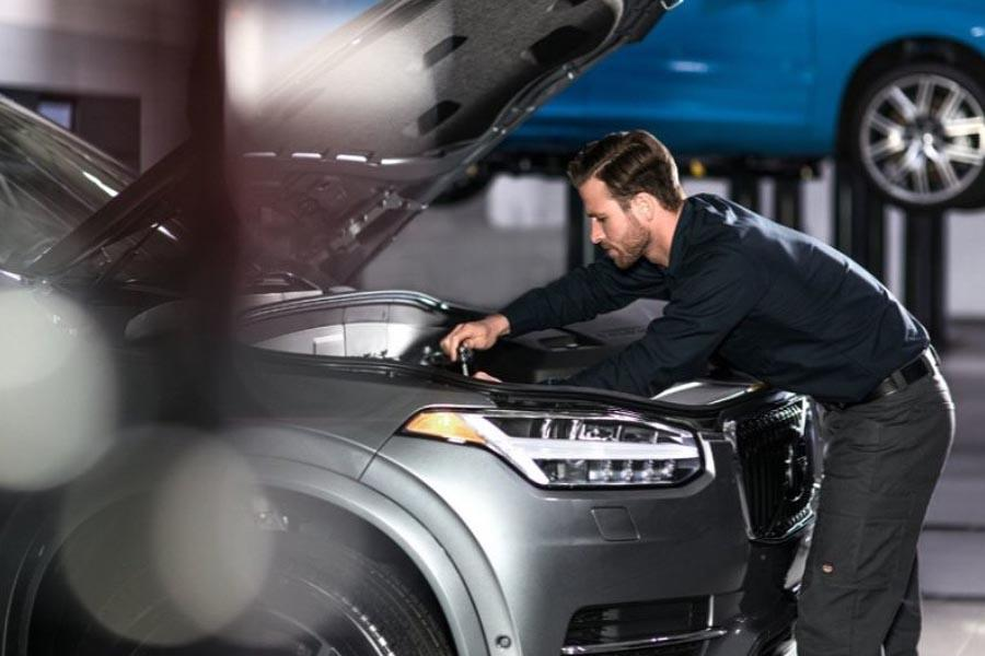 Volvo technician working on car