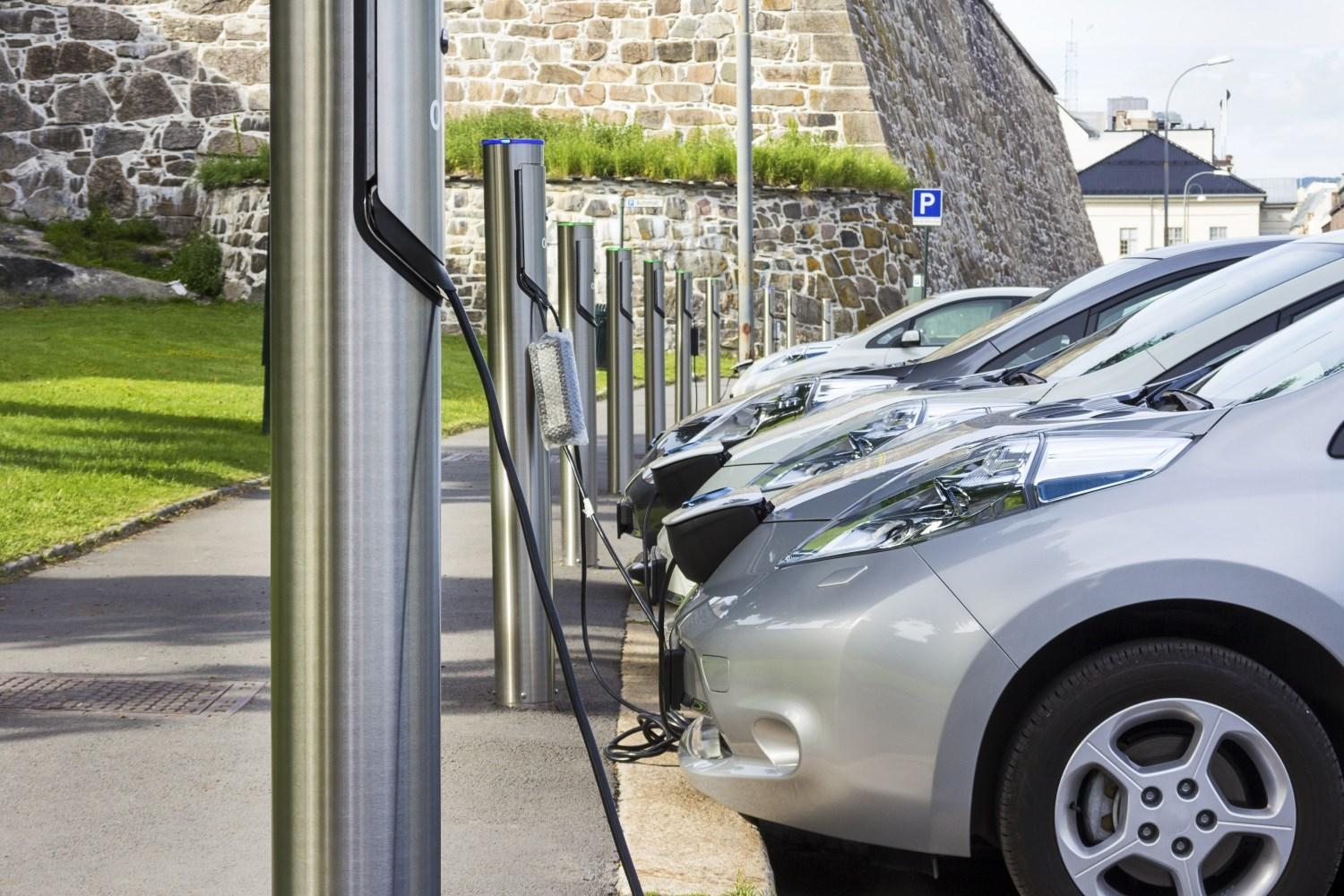 Electric cars charging at roadside