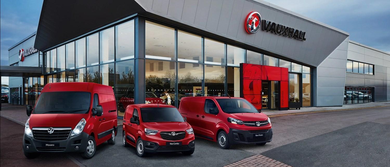 Red Vauxhall Van range outside dealership