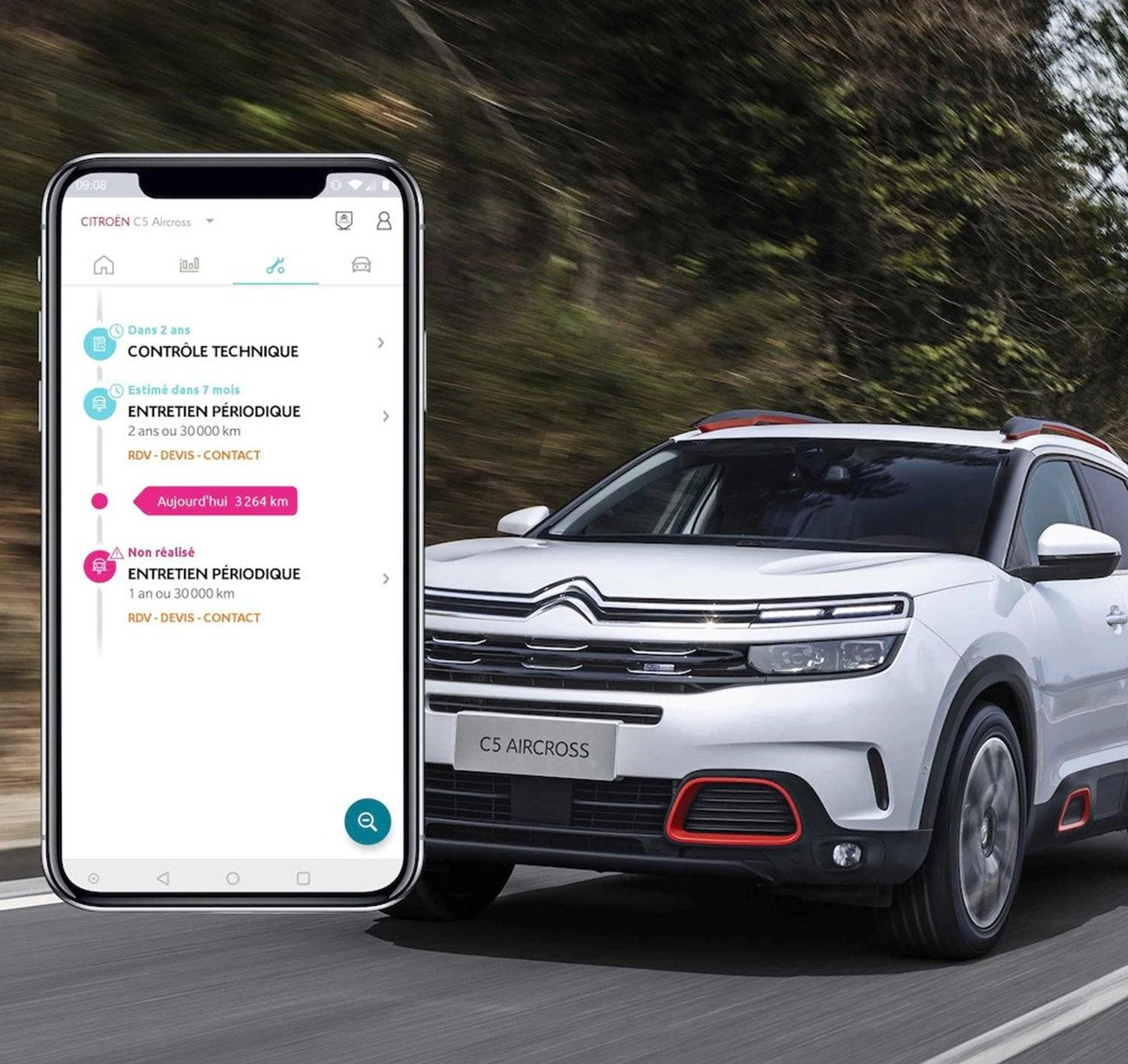 Example of Citroen MyApp on a smartphone with a Citroen driving in the background