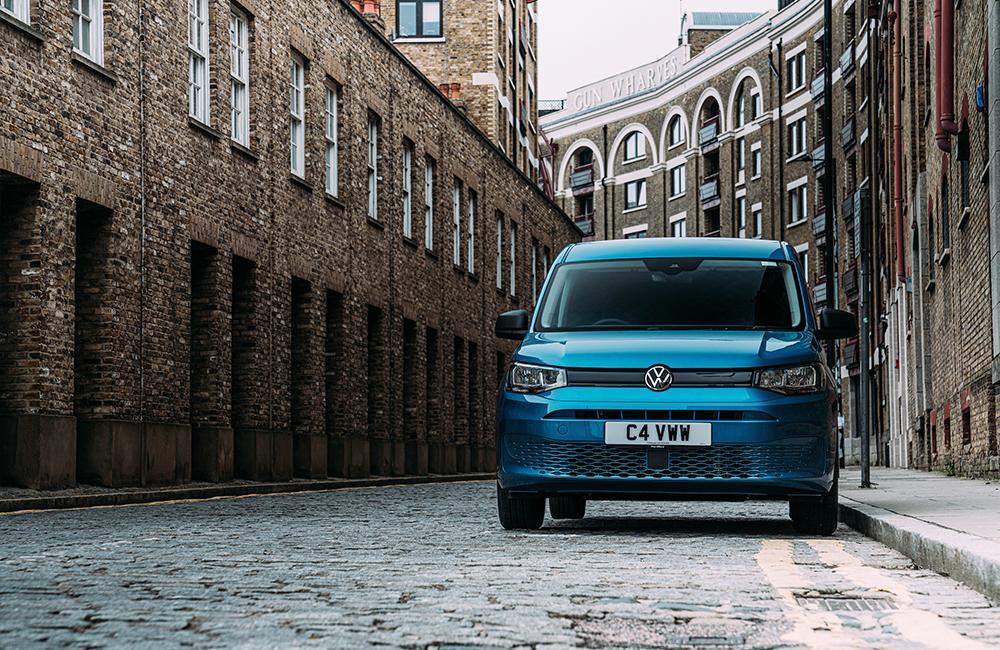 Blue Volkswagen Caddy on cobbled street
