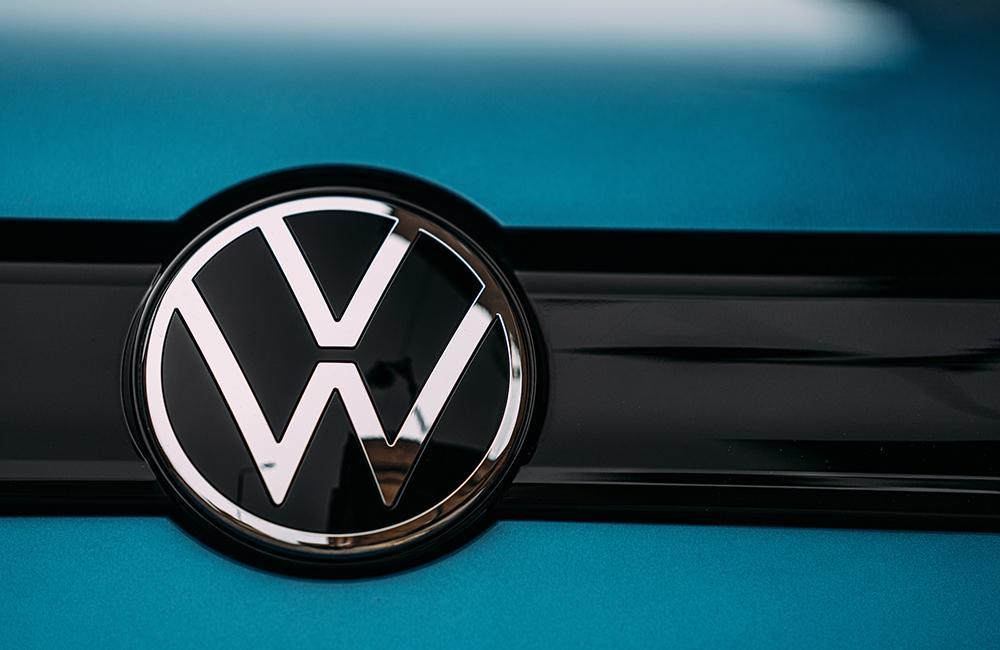 Volkswagen Logo on front of blue car